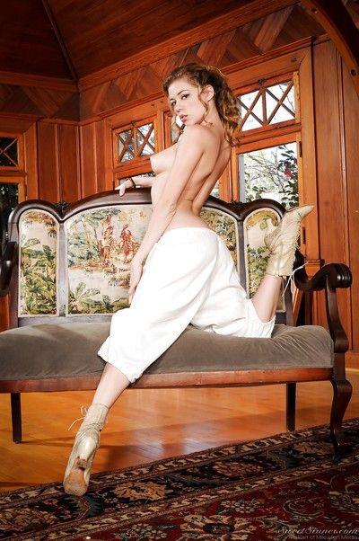Pornstar Nicole Ray strips off retro clothes to model nude in granny boots