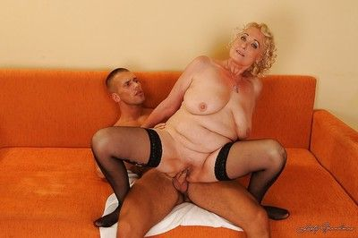 Lustful granny in stockings gets her pussy pleased with toys and young cock