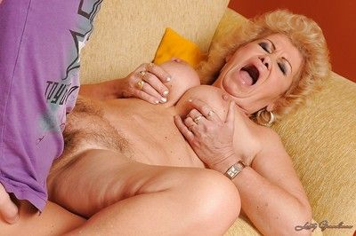 Horny granny with big round boobs gets fucked by a younger guy