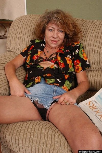Horny grandma Ivy pinching her hard nipples while undressing
