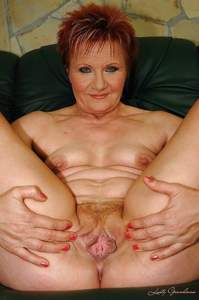 Redhead granny with tiny tits shows her shaved cunt and her hot ass