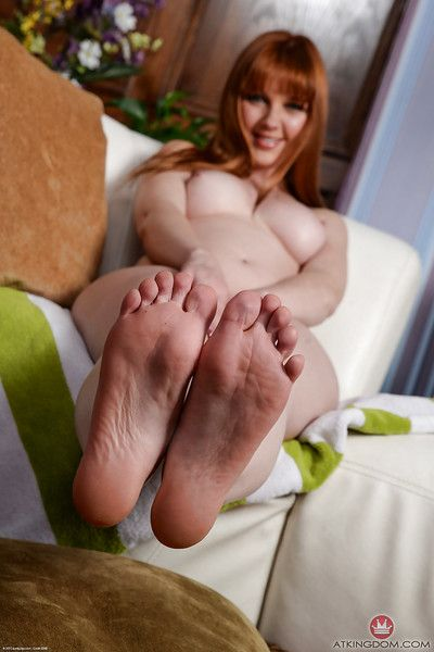 Older redhead Marie McCray displaying bare feet before loosing nice tits