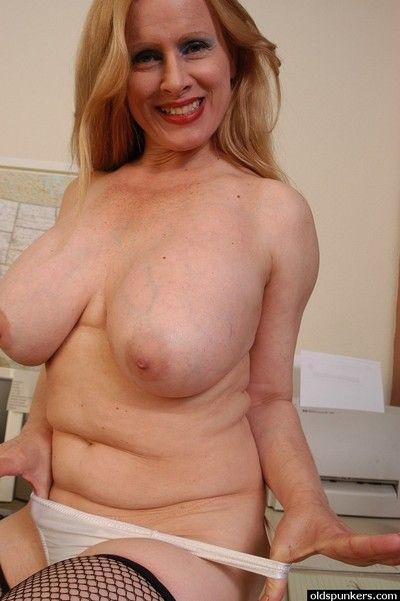 Buxom mature secretary Lavender lets her huge tits loose at work