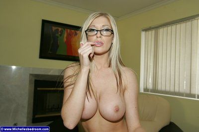 Tall slim lingerie milf Michelle Barrett in glasses removes her bra and displays her gorgeous juggs