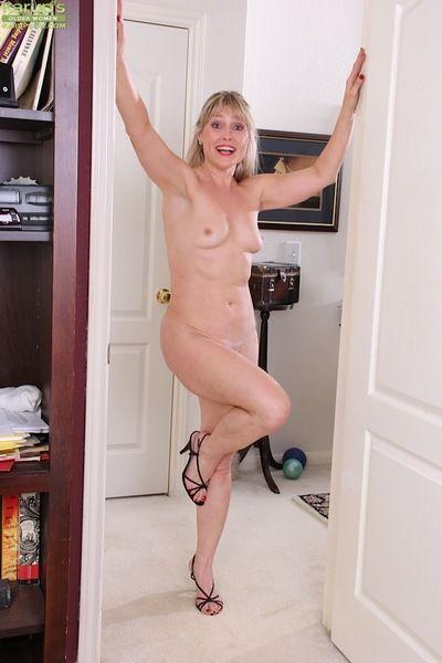 Older dame Rebecca Hill flashing upskirt ass in thong and heels