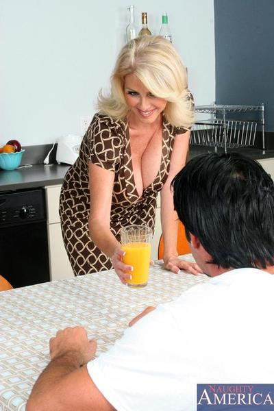 Juicy blonde milf Penny Porsche with huge hooters takes off her red lingerie for her bearded buddy