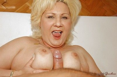 Buxom granny with big flabby boobs sucks and fucks a young dick