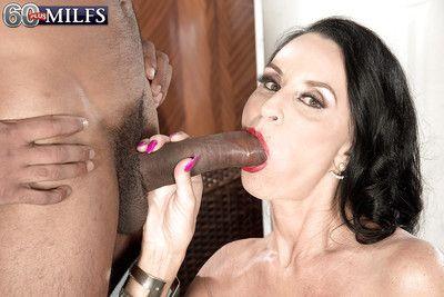 Buxom granny Rita Daniels giving massive black cock ball licking blowjob