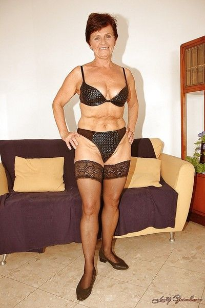 Short haired granny in stockings stripping off her dress and lingerie