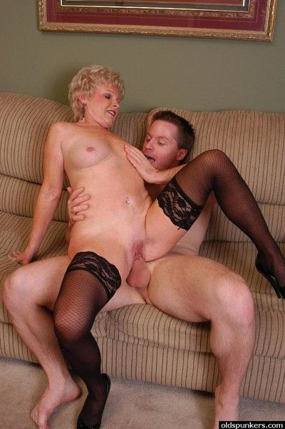 Aged blond lady Jewel taking cumshot on big tits after seducing younger man