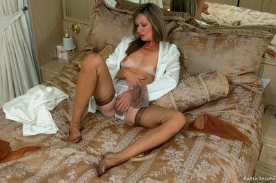 Clothed mature woman Satin Jayde undressing to show lace underwear