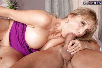 Big boobed granny Luna Azul taking facial cumshot after oral sex exchange