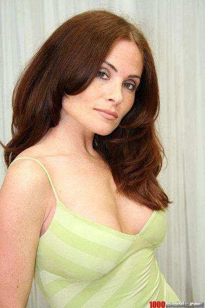 Good looking busty milf Ginger Lea in black panties strips off her green dress
