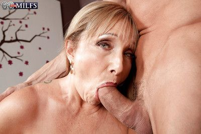 Big boobed granny Luna Azul taking facial cumshot after oral sex exchange
