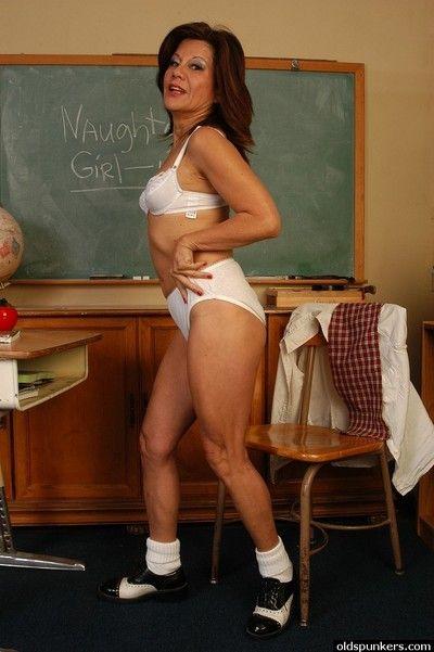 Mature porn model Melina dresses shaved granny pussy in schoolgirl skirt