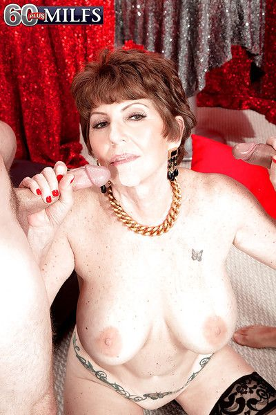 Bosomy granny in stockings Bea Cummins handles two cocks at the same time