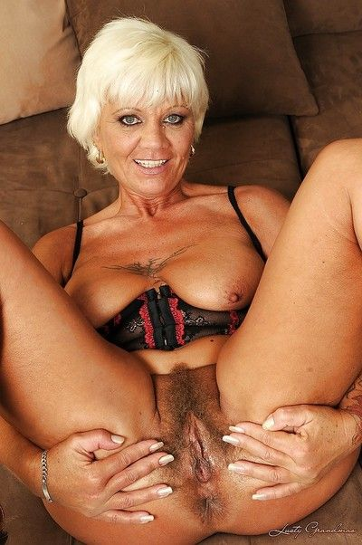 Filthy granny in lingerie uncovering her titties and shaggy twat