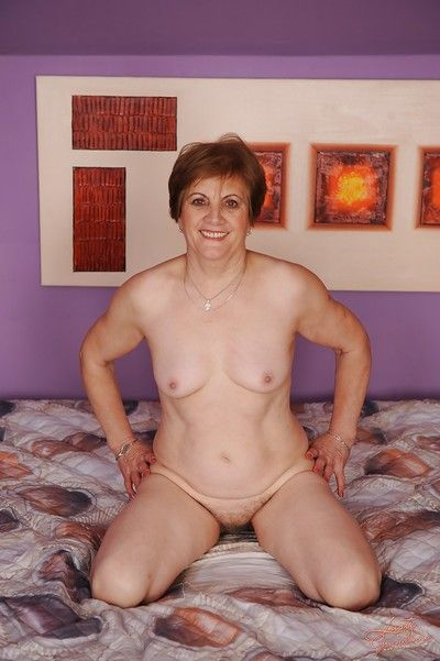 Naughty granny with hairy twat taking off her lingerie and spreading her legs