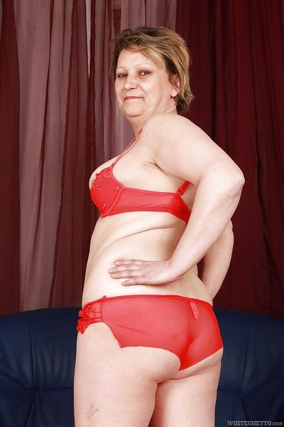 Filthy fatty granny with flabby boobs stripping off her clothes
