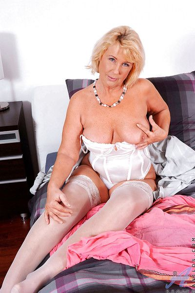 Granny with big tits Regie is masturbating with her favorite toys