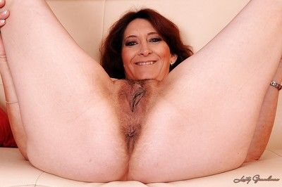 Curvy granny on high heels uncovering her fatty tits and unshaven cunt
