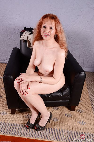 Older redhead babe with small tits sliding panties away from shaved pussy