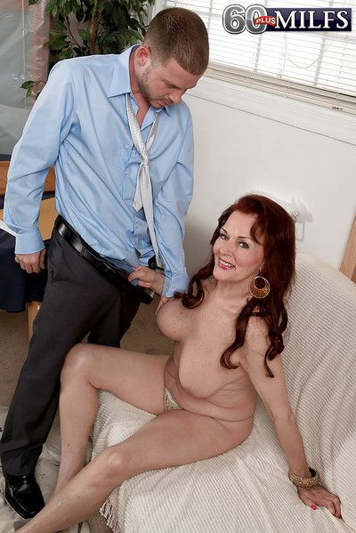 Redheaded granny Katherine Merlot displaying big saggy boobs while fucking