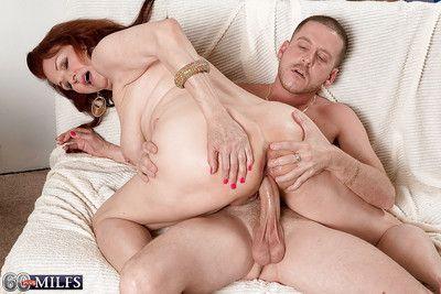 Redheaded granny Katherine Merlot displaying big saggy boobs while fucking