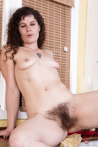 Leggy older lady Sunshine loosing really hairy cunt from skirt in kitchen