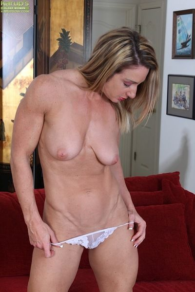 Mature woman Ashley Brooke sliding underwear over shaved pussy