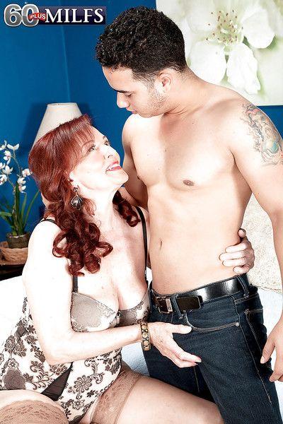 Redheaded granny Katherine Merlot sucking and screwing big cock in tan nylons