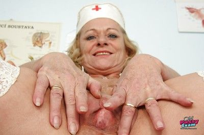 Curvaceous granny in nurse uniform masturbating her gloryhole