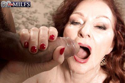 Chunky granny Katherine Merlot giving large cock blowjob and ball washing