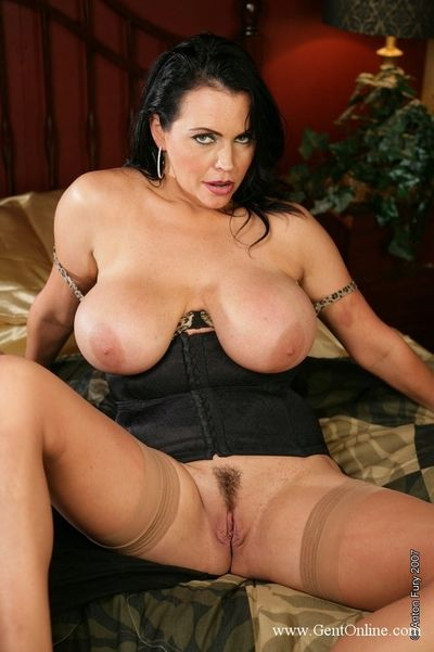 Delicious milf Angelica Sin shows off her massive melons then inserts red toy in her love hole