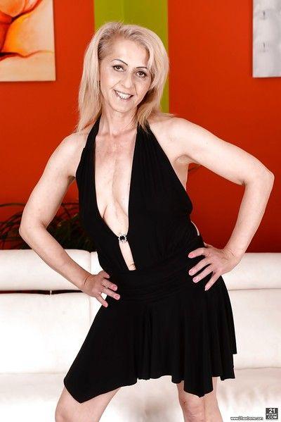 Hot blonde granny Ilona G loosing saggy tits from little black dress