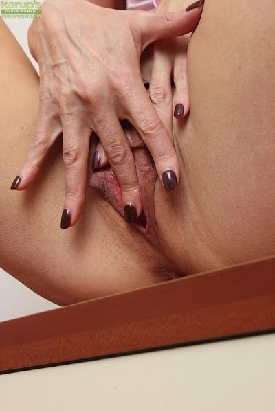 Brunette mature Melisa is teasing her tight ass while masturbating