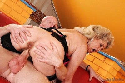 Busty granny masturbates her cunt with a toy and gets it fucked hardcore
