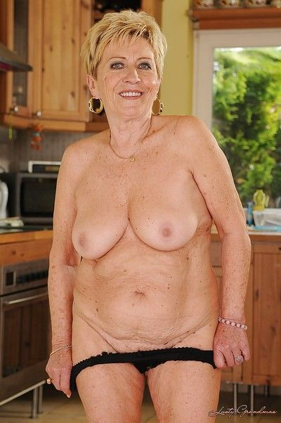 Lecherous blonde granny with ample ass gets rid of her lingerie