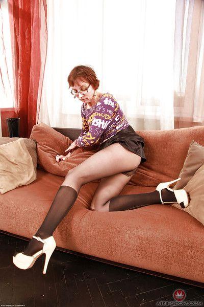 Redhead granny Sofia removing skirt and pantyhose for masturbation session