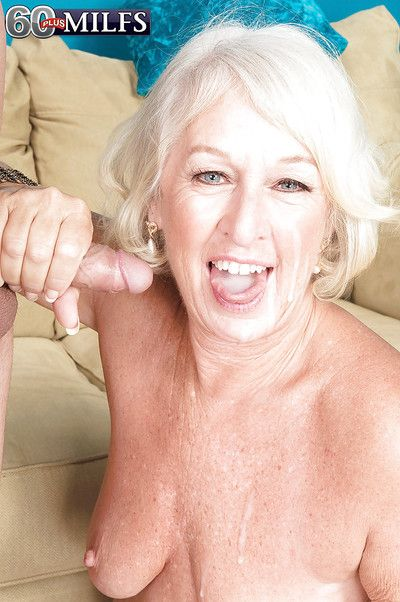 Platinum blond cougar Jeannie Lou strips down to hose for sex with younger man