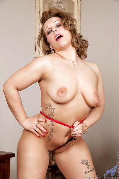 Shaved pussy of a mature fatty Ashley Rider shown in panties