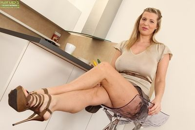 Buxom older lady Britney lifts blouse to reveal huge all natural juggs