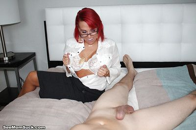 Older redhead Jeremy baring huge boobs while sucking cock in glasses