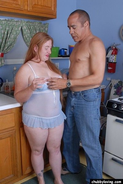 Obese redhead Keno giving a blowjob on her knees in kitchen