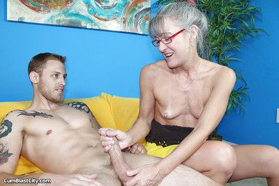 Granny with tiny tits adores working with delicious young daggers