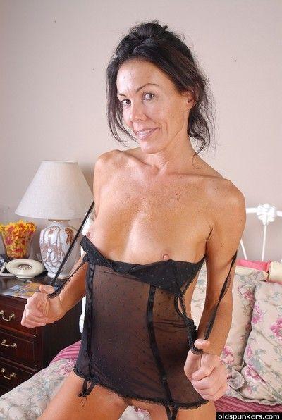 Mature brunette babe strips off lingerie before spreading her vagina