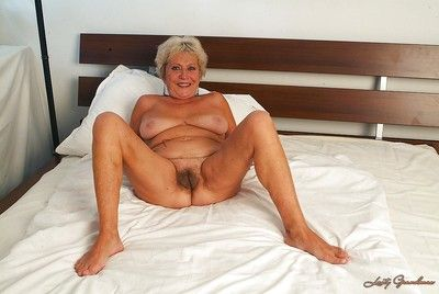 Lecherous granny with unshaven cooter getting naked and spreading her legs