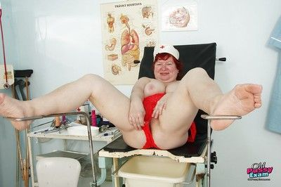 Fatty granny with flabby jugs and hairy muff taking off her nurse uniform