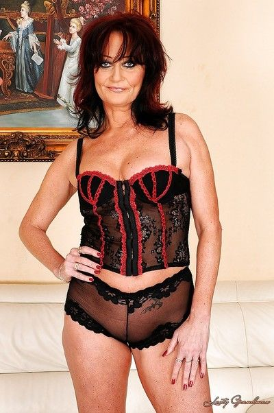 Sexy granny poses in lingerie and strips her panties to expose pussy