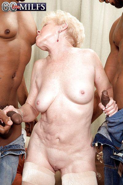 Naughty grandma Jewel giving oral sex to 2 big black cocks at once